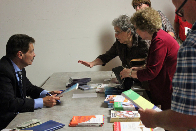 Dr Ray talking to book signers2.jpg