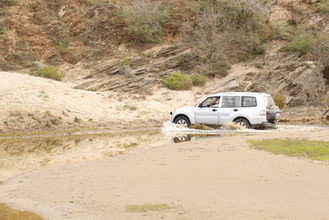 4x4 vehicle playing in the river