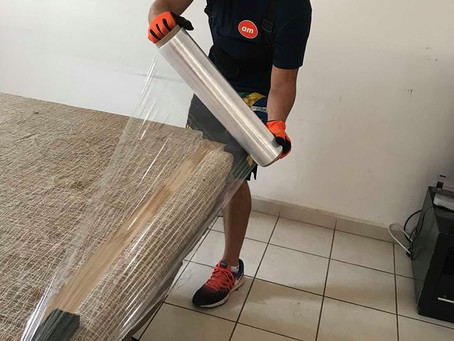 DIY Moving: Preparing Your Glass Table with A Standard Household Blanket & Shrink Wrap.