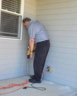 Drilling a stoop for a Termite treatment
