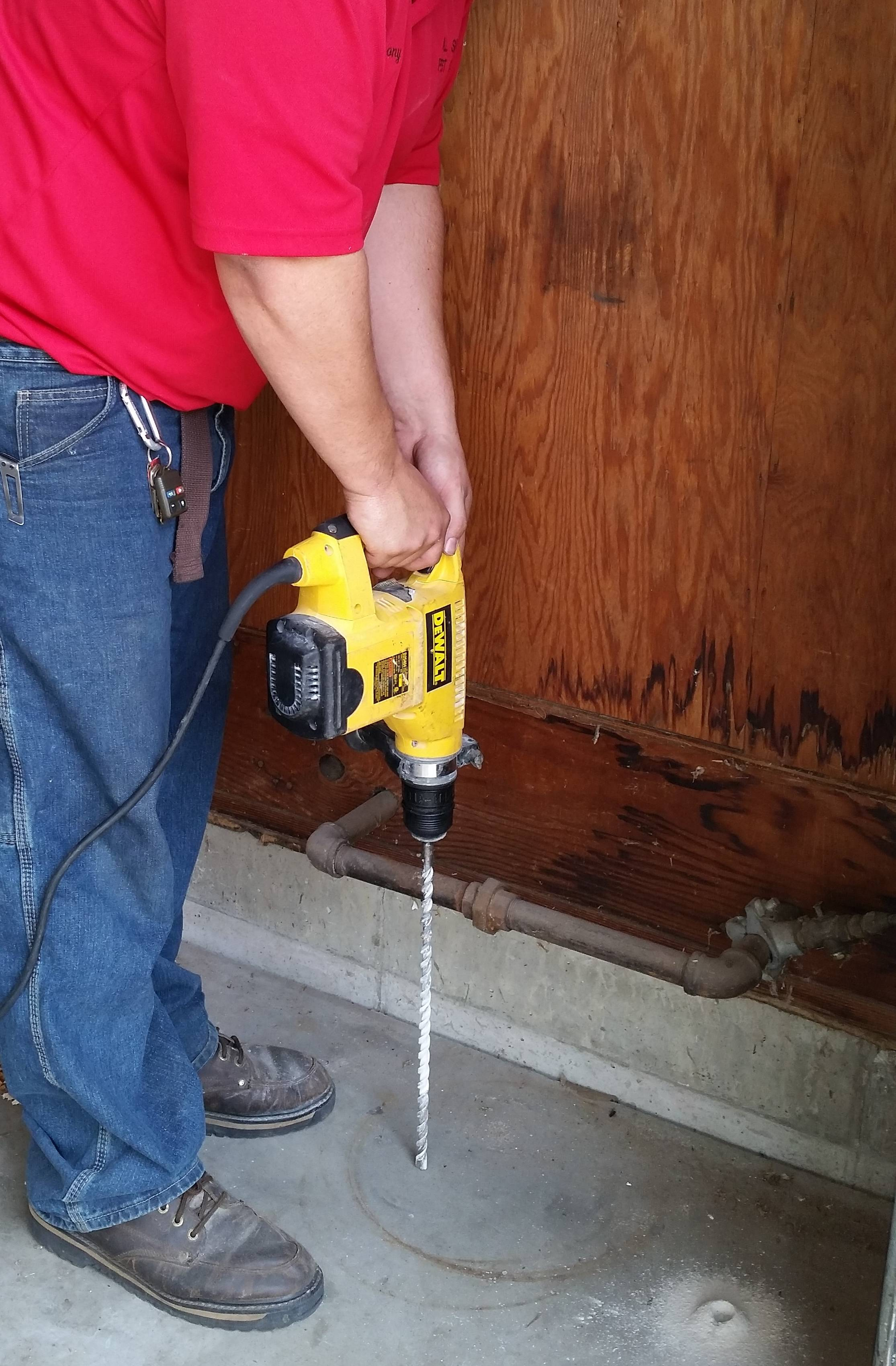 Drilling a garage floor.
