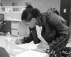 girl writting BW.png