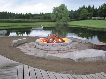 Outdoor custom firepit designed by The Fireplace Shop Ltd.