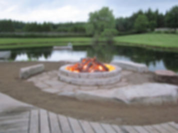 Outdoor custom firepit designed by The Fireplace Shop Ltd.