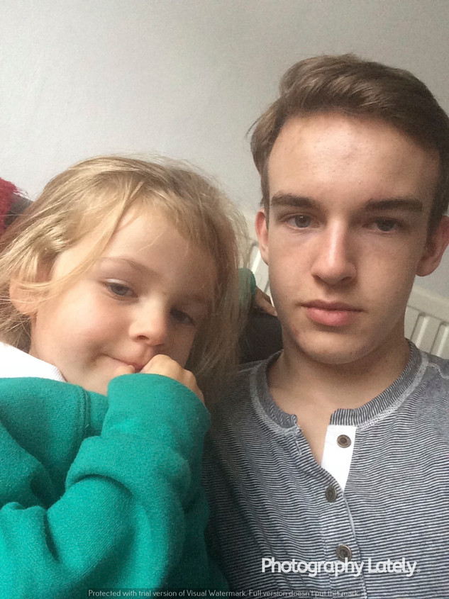 Edie Taylorian beside her older brother, Cometan