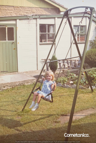 Young Louise Counsell On The Swing