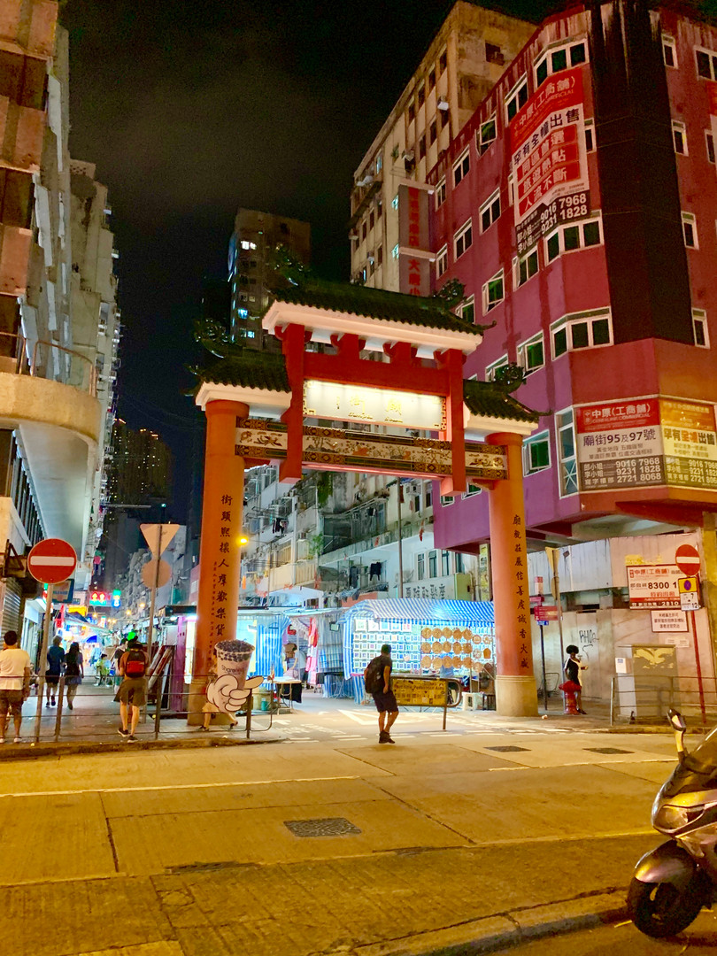 Traditional Gateway in Downtown Hong Kong by Cometan