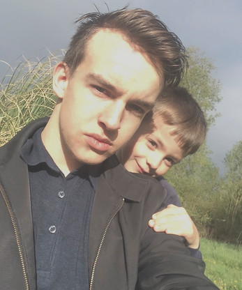 Kent Taylorian Alongside His Brother, Cometan