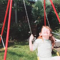 Lucia Natalie Swinging.jpg