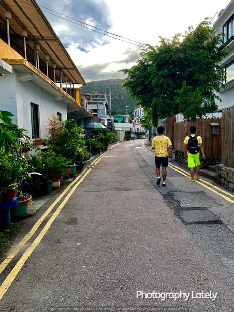 MK & Heastward Walking Through The Village Near Hong Kong Taken by Cometan