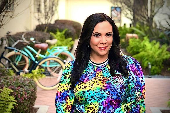 Gloria Calderon Kellett headshot.JPG