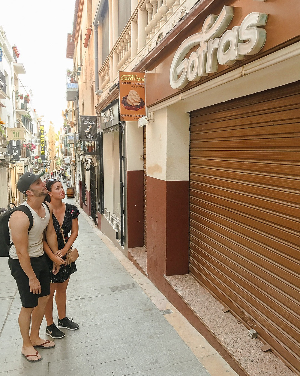 Closed Gofras waffle restaurant in sitges barcelona spain, sad, disappointed people.