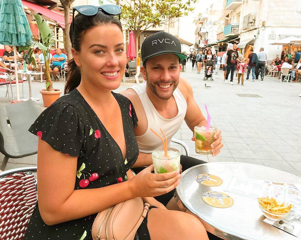 Friends drinking cocktails in carrer del pecat in Sitges Barcelona Spain