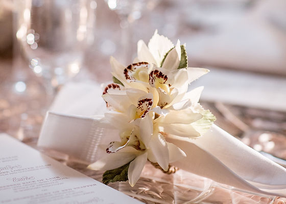 Floral napkin rings at a luxury wedding at the Pierre Hotel in New York City.  Flowers and decor by Stephen Kolins, wedding planned by luxury event coordinators Imagine Party and Events.  Luxury wedding with lush white flowers and vintage furniture.