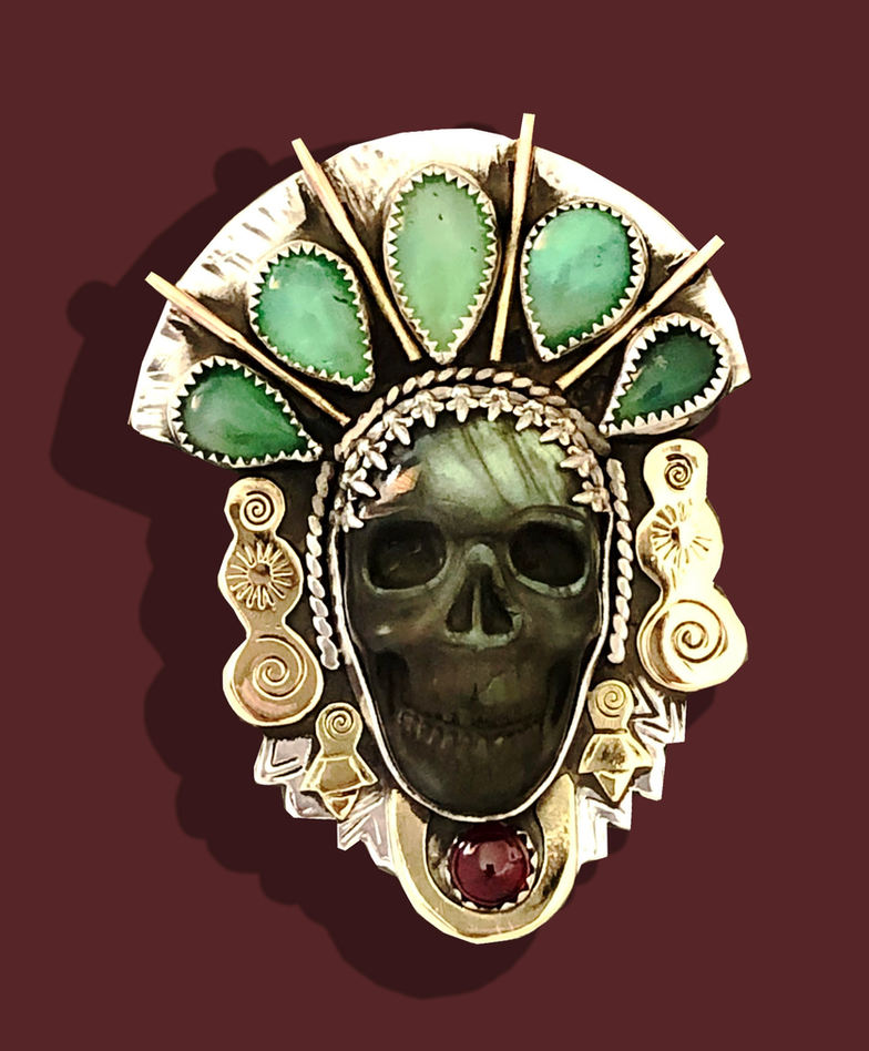 Ana Marina Sánchez (Denver, CO). Méxica Warrior Priestess. Mixed metals and stone carved pendant, 2020.