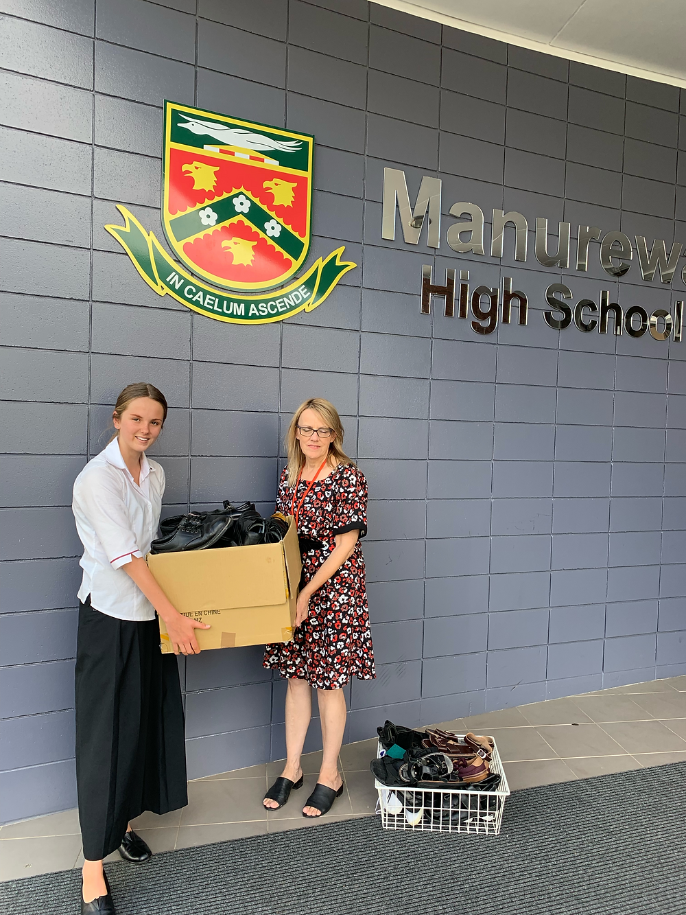 Founder of Second Step Exchanging shoes with Manurewa Highschool