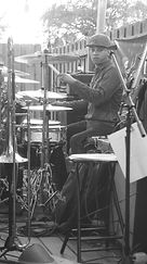 Longineu Parsons III playing drums at a gig