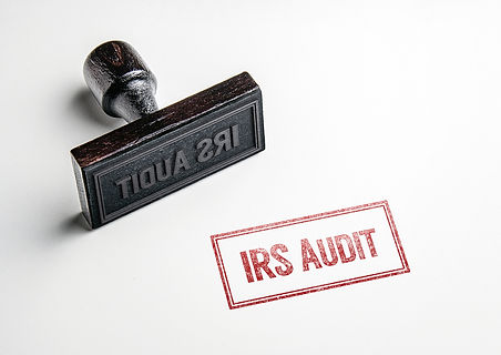 Rubber stamping that says 'IRS Audit'..j