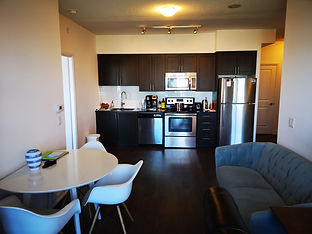 7890 Bathurst 1010- living & kitchen.jpg