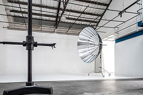 photo studio hire, the drive-in studio, 170sqm, U shape cyclorama, 4.6m ceiling height, 12'x12' scrim included black/white polly boards, makeup station, plenty of parking