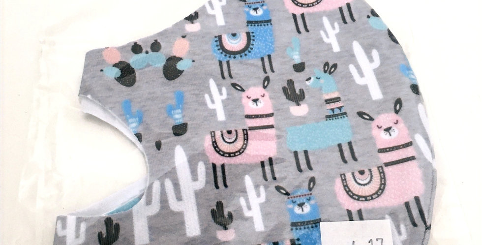 Side view of folded light grey mask with pink, blue &turquoise llamas print