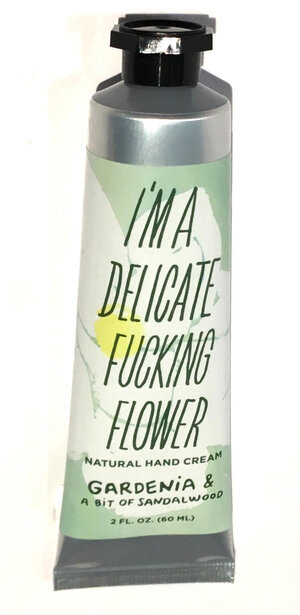 Green & white tube - hand cream labeled I'm a Delicate Fucking Flower Natural Hand Cream, Gardenia with a bit of Sandalwood