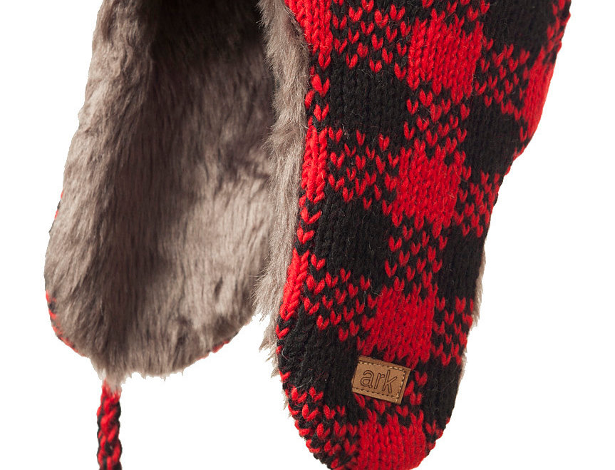 Side view of black & red check cable knit wool hat with long earflaps & unturned front brim-shaggy lining