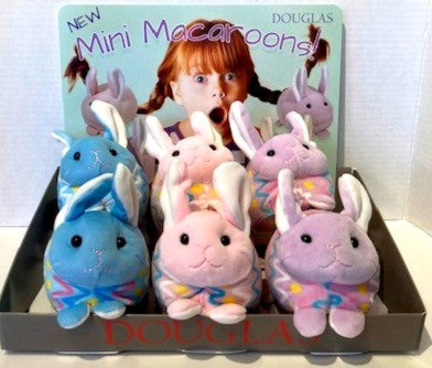Display box of 6 mini macaroon stuffed toy bunnies decorated like Easter eggs
