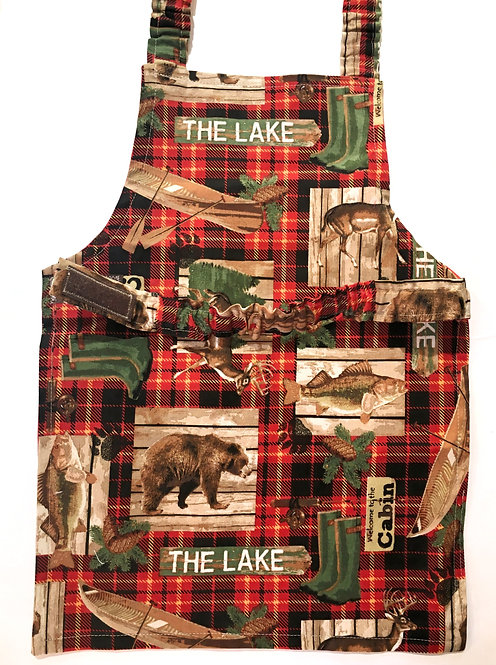child's apron-red & black plaid with brown & green patches with bears, fish, canoe and white words 'The Lake'