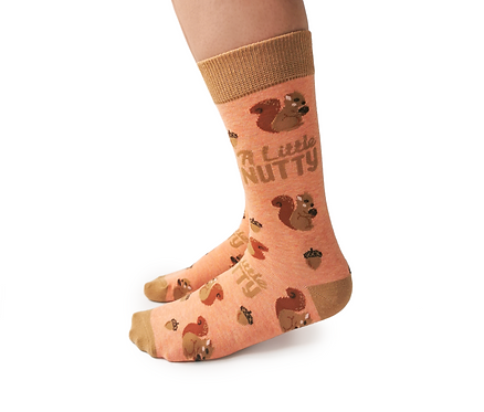 Left view of feet wearing peach socks with red & brown images of squirrels-Print on Socks 'A Little Nutty'