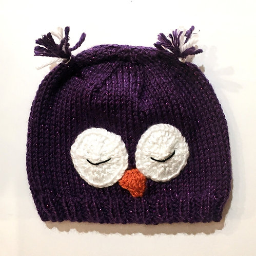 knit infant cap sparkly purple with 2 sleeping owl eyes & beak stitched on-ear tassels at top