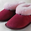 Pair of rose sheepskin slippers-angled view