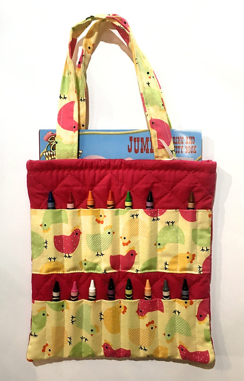 Flat rectangular red cotton tote bag holding a crayon book & 16 slots for crayons on the front