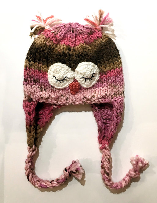 Pink & green knit childs hat with earflaps & chin ties-owl eyes & beak stitched on-ear tassels at top of crown