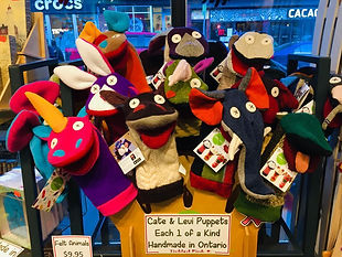 Many colorful Cate & Levi Puppets on display at Tickled Pink Ottawa