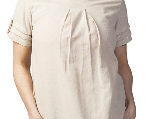 Woman modeling Olga Tunic Dress natural with short sleeves round neck A-line front gathers at neck 2 outer pockets with ties