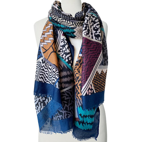 Body form with multi-colored mosaic patchwork scarf looped around neck