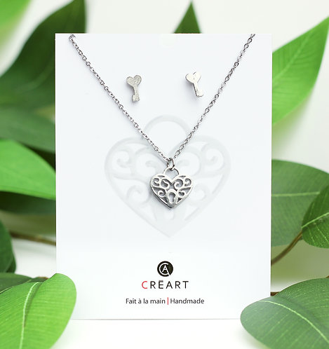 Green & white card displaying pewter chain, pendant & earring set in filigree heart & key shapes