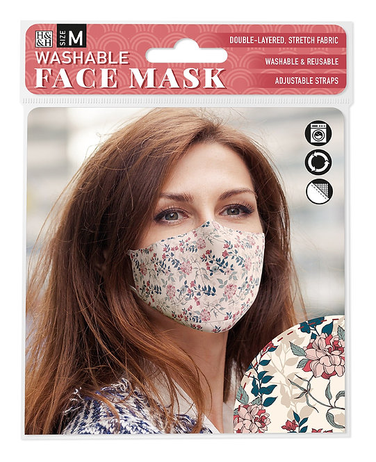 Packaging showing model wearing pink green & blue floral print mask on cream background
