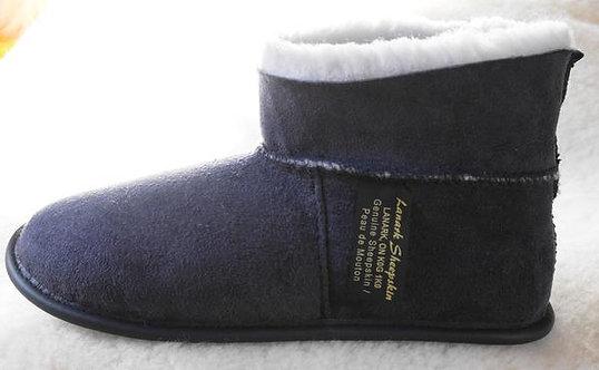 Side view of kids denim sheepskin slipper with cuff turned up