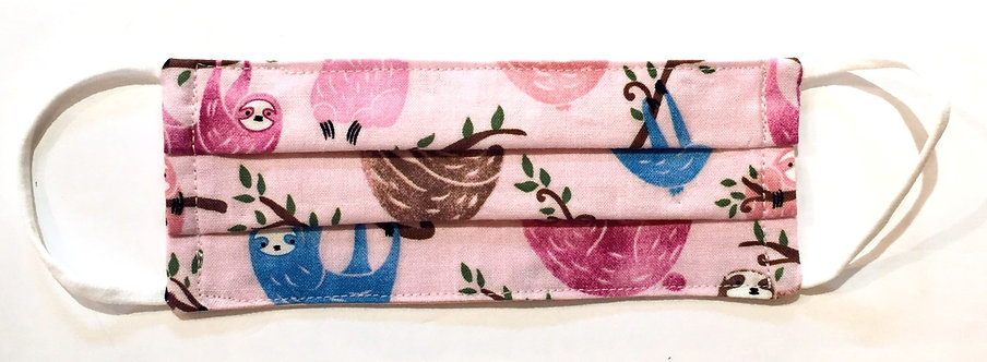 Tiny pink cotton mask laid flat with pink, brown & blue sloths print