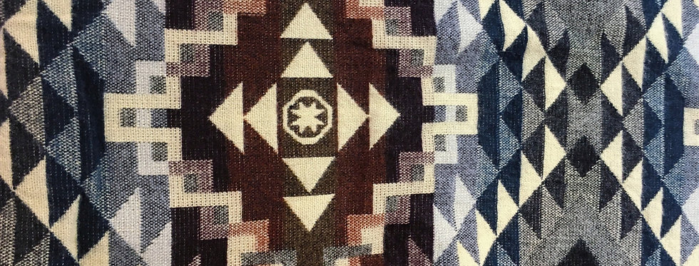 Close up of red, white & blue geometric patterned blanket