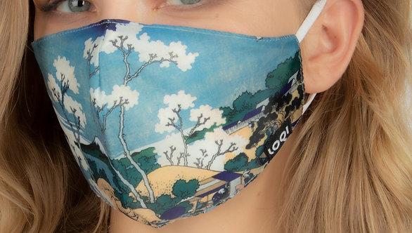 Side view close up of model wearing snug fitting face mask-reproduction of Katsushika Hokusai's Fuji From Gotenyama