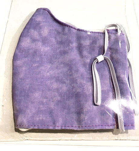Close up of lilac cotton protective mask folded in half