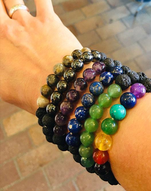 woman's arm wearing multiple lava bead stretch bracelets