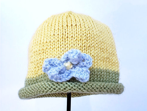 Yellow Hand Knit Infant Hat with green brim and blue knit flower attached