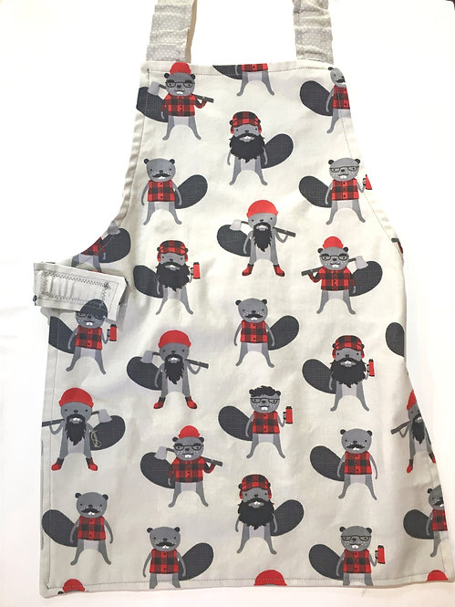 Child's apron white with brown beavers wearing red-checkered clothes