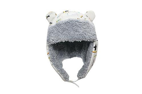 Front view white water repellent trapper hat with skiers print & gray sherpa lining with earflaps down