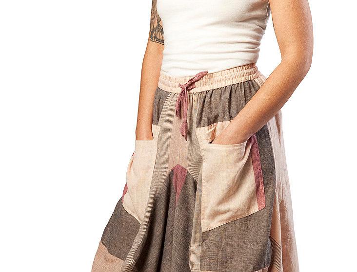 Fair Trade long cotton skirt elastic waist 2 large outer pockets uneven hem large blocks of rose natural & brown