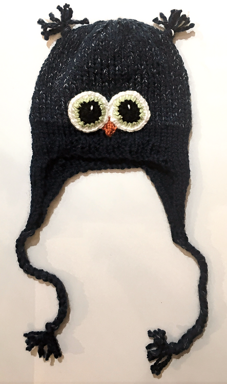 Navy knit childs hat with earflaps & chin ties-owl eyes & beak stitched on-ear tassels at top of crown